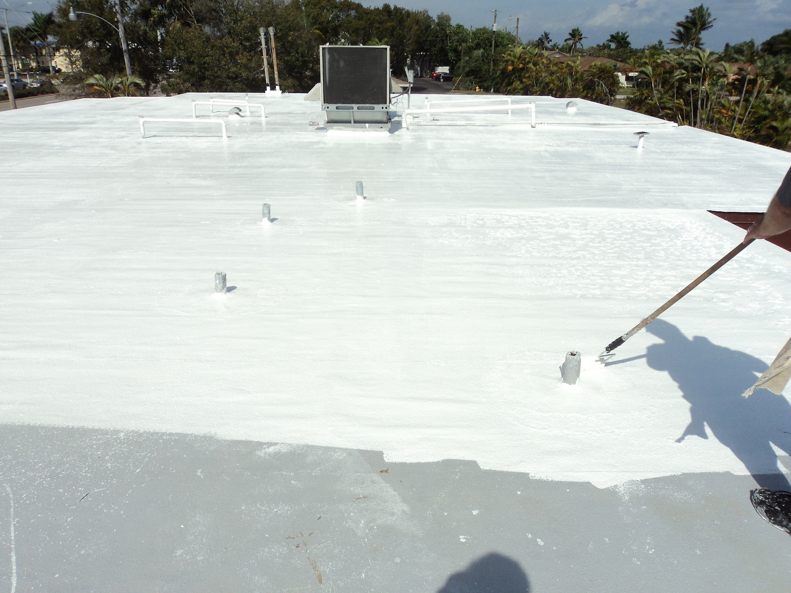 Applying roof coating