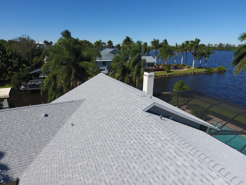 shingle roof with low profile ridge vent and chimney also dryer vent and plumbing stacks